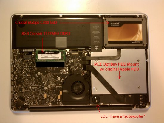 MacBook Pro internals with upgrades labeled: Crucial C300 6Gbps SSD, 8GB 1333MHz DDR3 RAM, MCE OptiBay Hard Drive bay